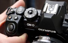 Olympus to quit camera business after 84 years
