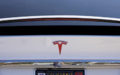Tesla Inc is issuing two recalls covering about 9,500 vehicles for roof trim