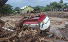 At least 101 people died as flash floods and landslides hit Indonesia and East Timor