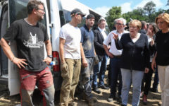 Merkel visits 'surreal' flood zone as death toll rises